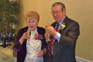 LubyAnn and Robert Hausman toast at their 50th wedding anniversary